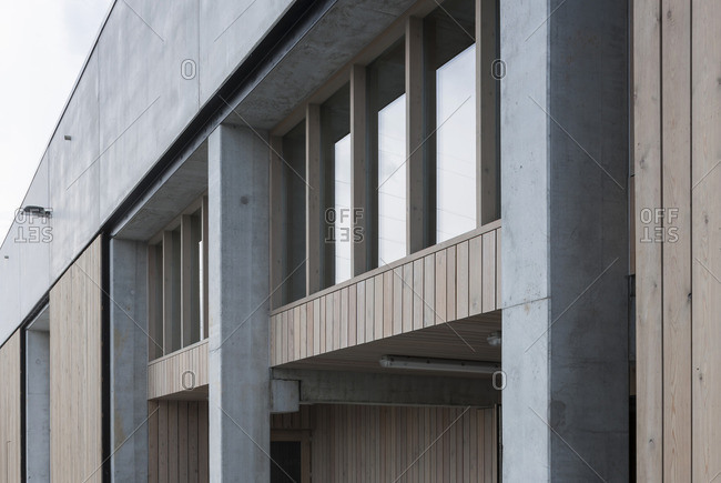 Wood plank panels and windows on exterior of a minimalist-designed building