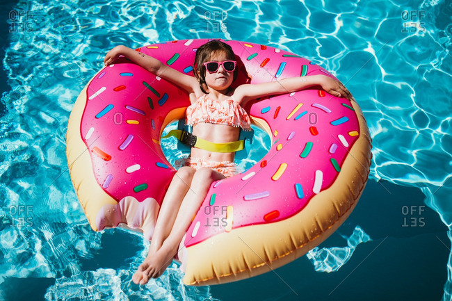Little girl floating in a donut inflatable