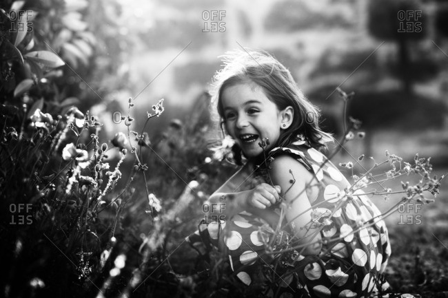 Happy girl looking at flowers