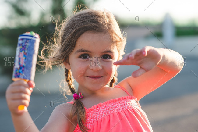 Smiling little girl holding ice cream treat