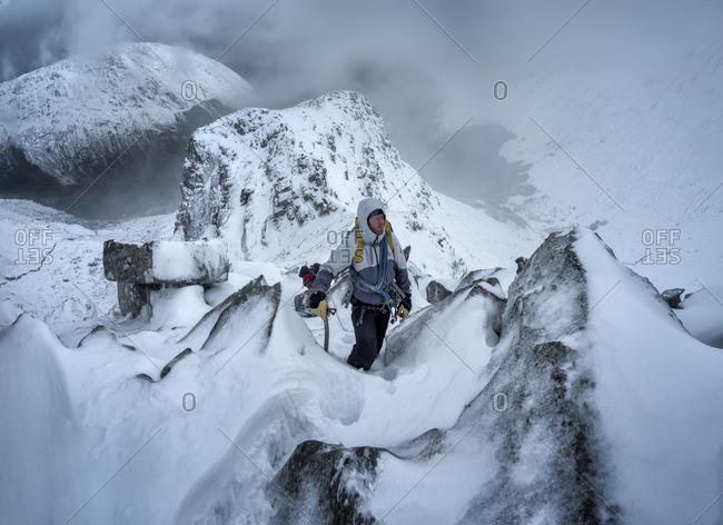 Two men climbing wintery mountains
