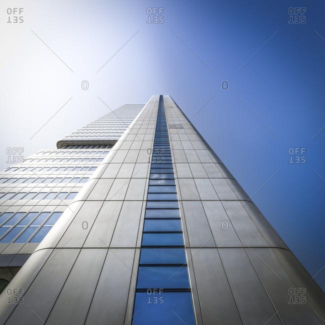 Facade of modern skyscraper seen from below
