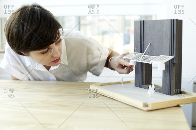 Woman checking architectural model