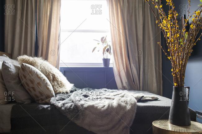 Interior of brightly lit bedroom