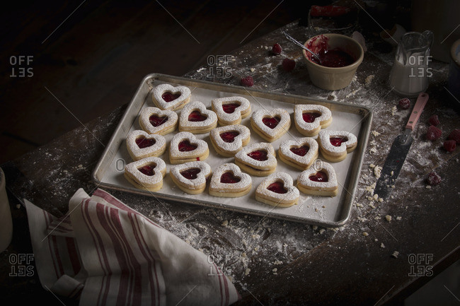 High angle view of a baking tray with heart shaped cookies