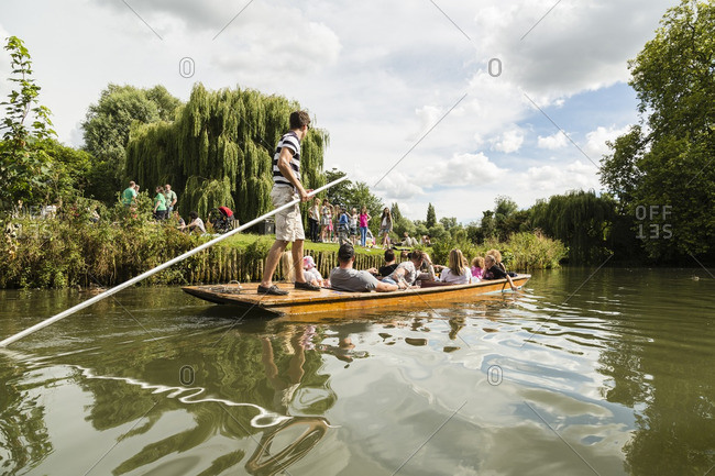 Cambridge, United Kingdom - July 6, 2014: Tourists on a boat on the River Cam