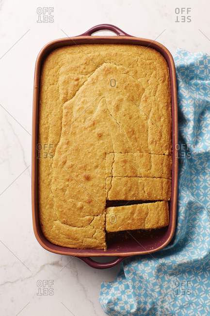 Sliced cornbread in a ceramic baking dish