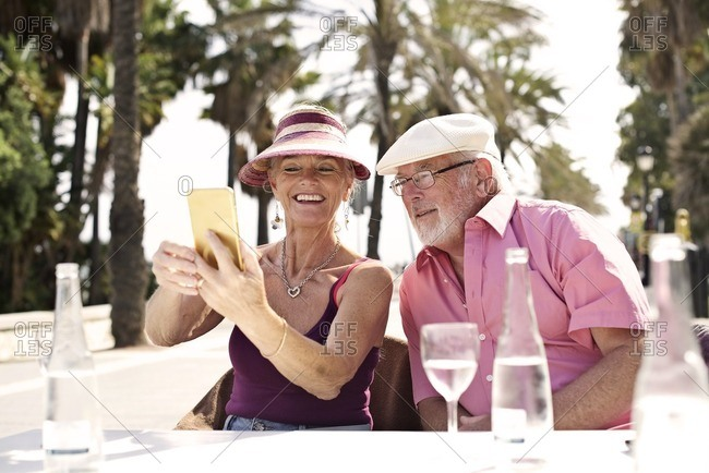 Senior couple taking selfie while on vacation
