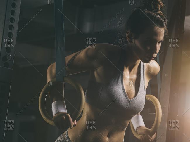 Female athlete, gymnastic rings - Offset