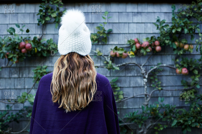Rear view of a girl wearing white knit hat