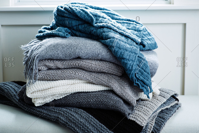 Stack of blue and gray wool blankets
