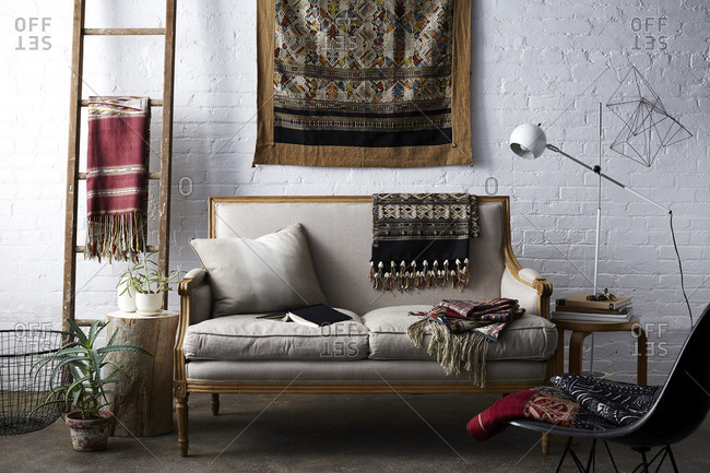 Living room interior with several hand woven blankets