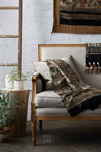Living room interior with couch and hand woven blankets