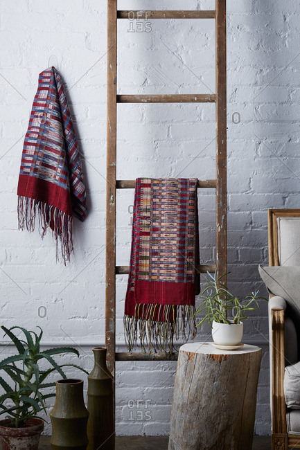Wooden ladder with hand woven blankets