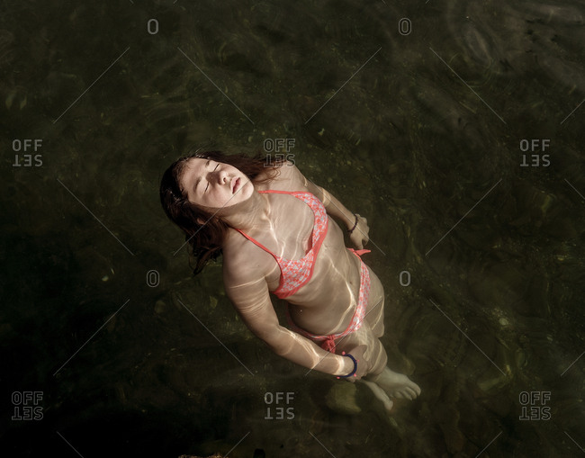 Woman floating submerged in lake