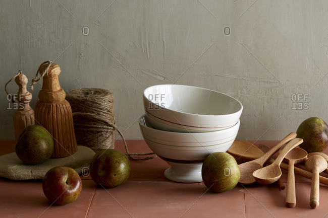 Still life with bowls and plums