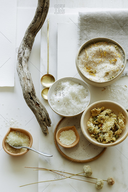 Still life with bath salts, bath tea, and a piece of driftwood