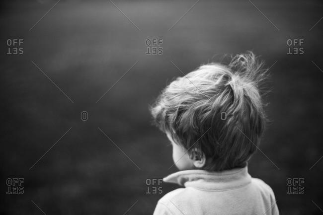 Boy facing away outside