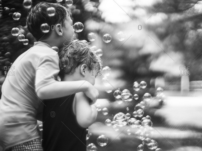Boys playing with bubbles