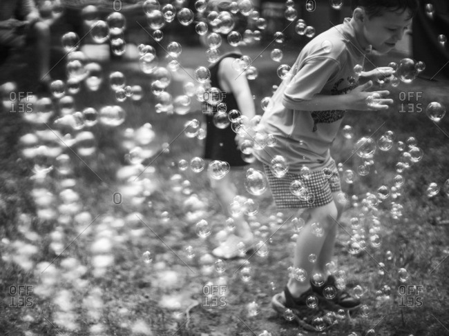 Boys standing among bubbles