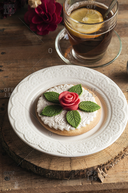 Tea time in the afternoon, tea with lemon and decorated cookie