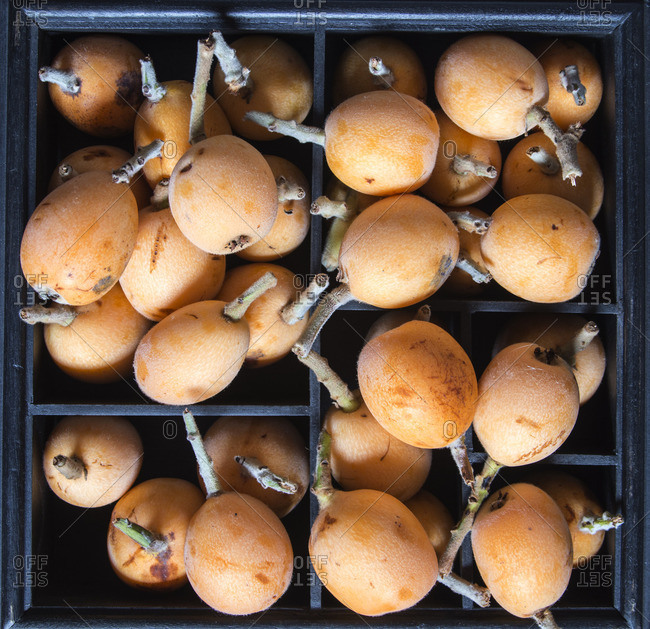 Loquat fruit in wooden box