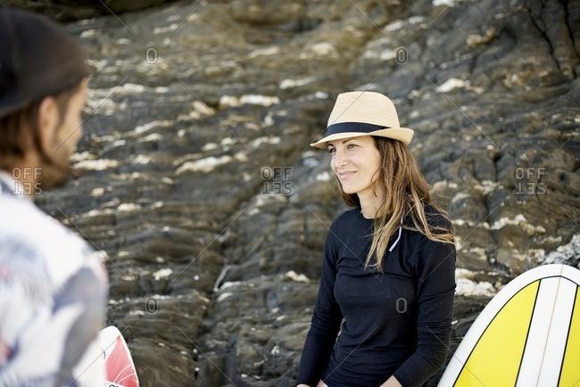 Female surfer smiling at man