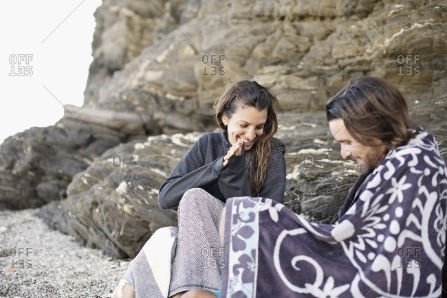 Couple on beach in blankets