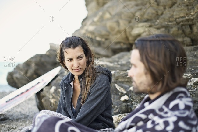 Woman gazing at man on beach