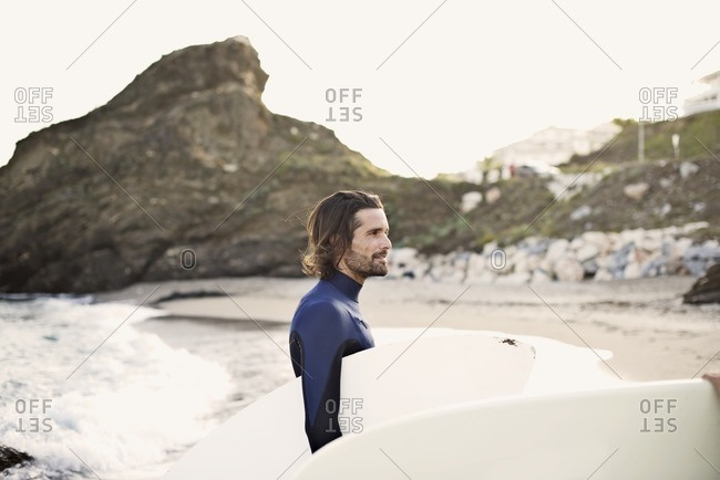 Male surfer staring out to sea