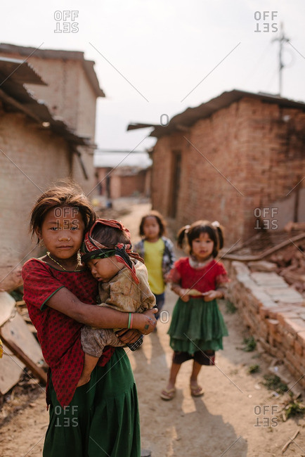 Nepal - March 19, 2016: Children standing together outside in a dusty alley