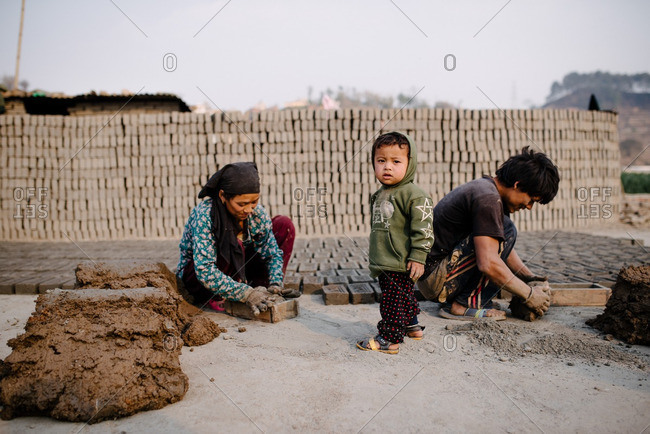 Nepal - March 19, 2016: Family of brickmakers working together outside
