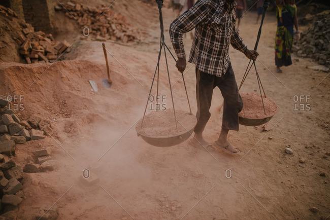 Man carrying a yoke in Nepal