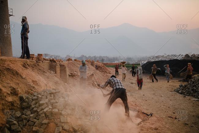 Nepal - March 19, 2016: Men working outside near a brick kiln