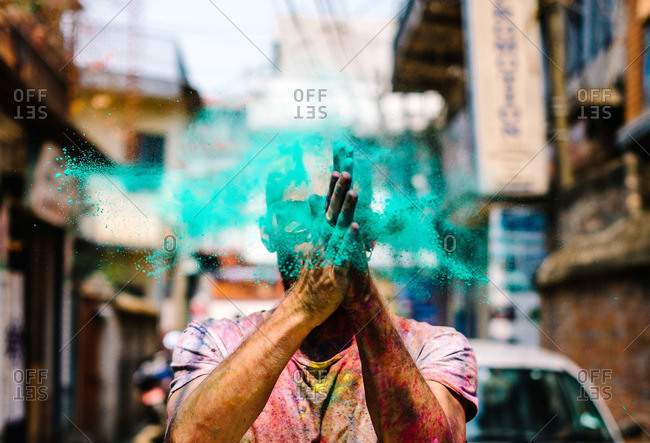 Man tossing dye at a Holi Festival in Nepal