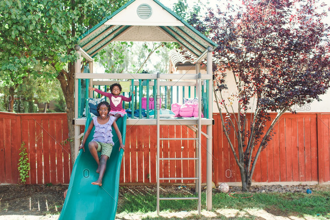 Two girls playing together in their backyard