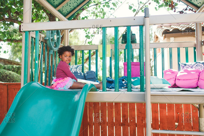 Girl playing in an outdoor play structure