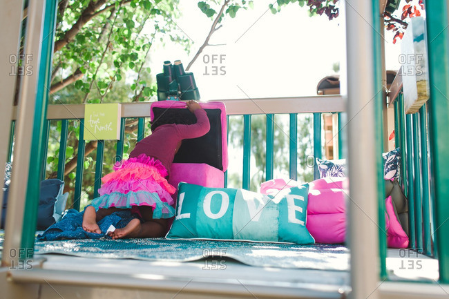 Girl searching for toys in an outdoor play structure