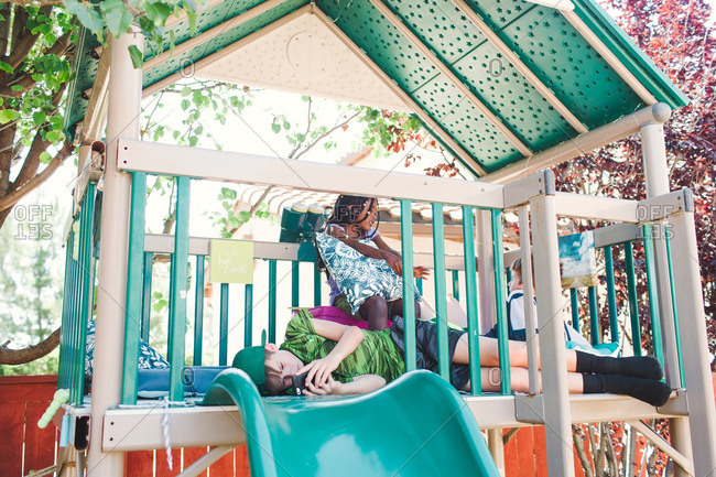 Children playing together in outdoor play structure