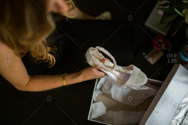 Woman getting bridal shoes out of box