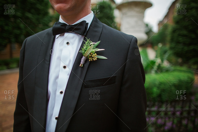 Groom in tux with leafy boutonniere