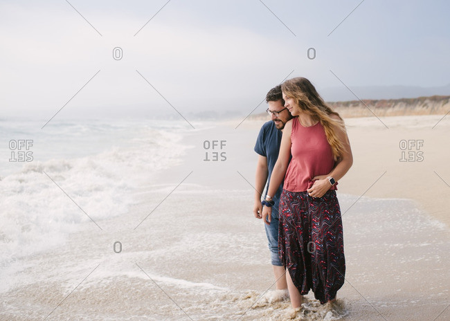 Couple looking out at the ocean together