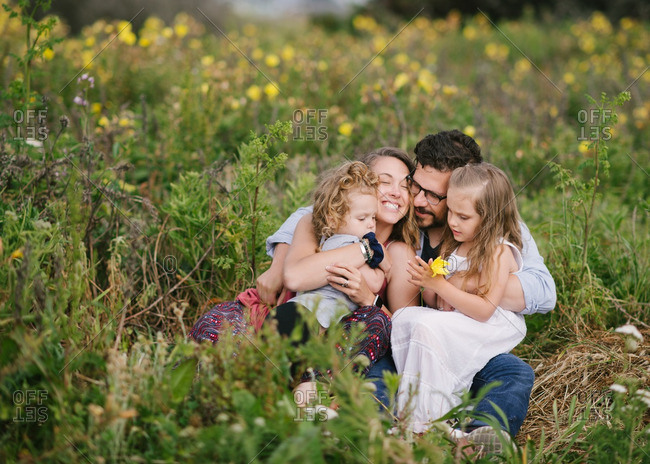 Family embraced in a field