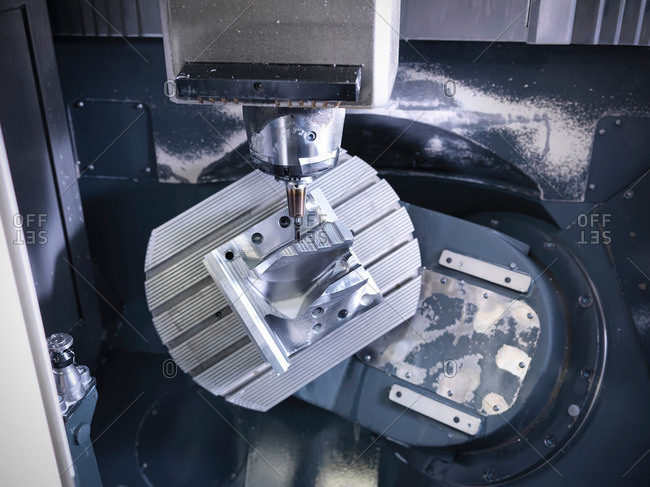 Complex steel part on computer numerical controlled, CNC, lathe in factory