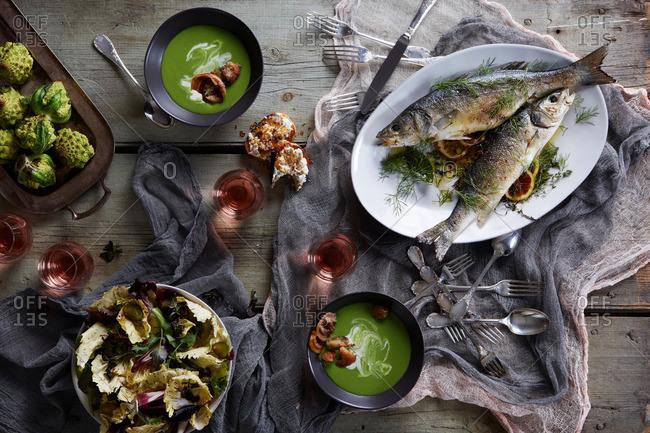 Still life with branzino fish and soup