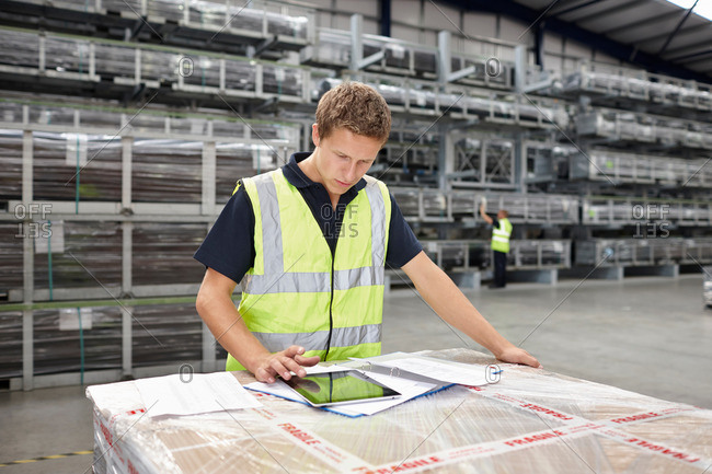 Warehouse worker preparing order in engineering warehouse