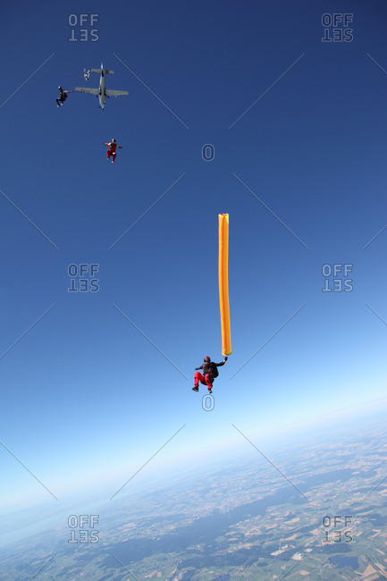 Skydivers free falling with air tube above Leutkirch, Bavaria, Germany