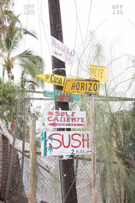 Baja, Mexico - June 17, 2016: Street signs on a pole in Baja, Mexico
