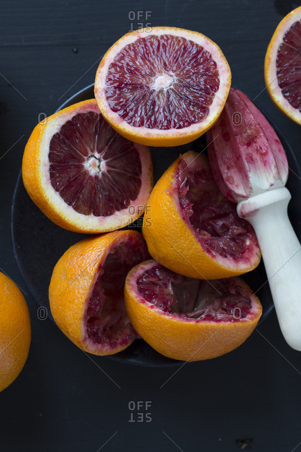 Blood oranges in the process of being juiced