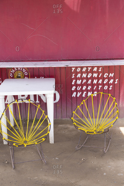 Baja, Mexico - June 17, 2016: Dining table and chairs at an outdoor diner
